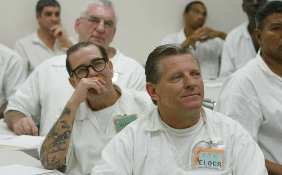 Inmates James Schneider, front,  A. Osborne and Jimmy Burnett listen to Carter MacKenzie discuss job placement after their release from the Hamilton Unit in Bryan. Photo: Steve Campbell, Chronicle