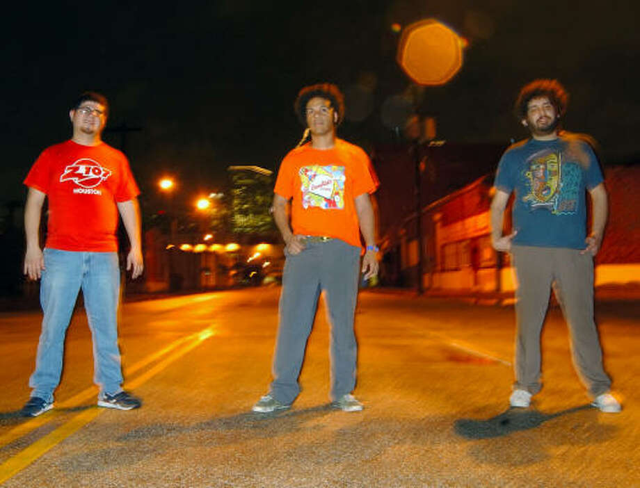 Satin Hooks is, from left, David Gomez, Kerry Melonson and Lucas Gorham. Photo: Tre' Ridings, For The Chronicle