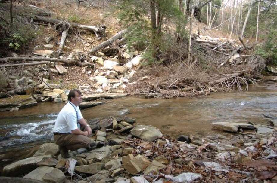 Jim Finley monitors the effects of mineral harvesting on Hamilton County, Tenn., waters. Photo: MARK GILLILAND, AP