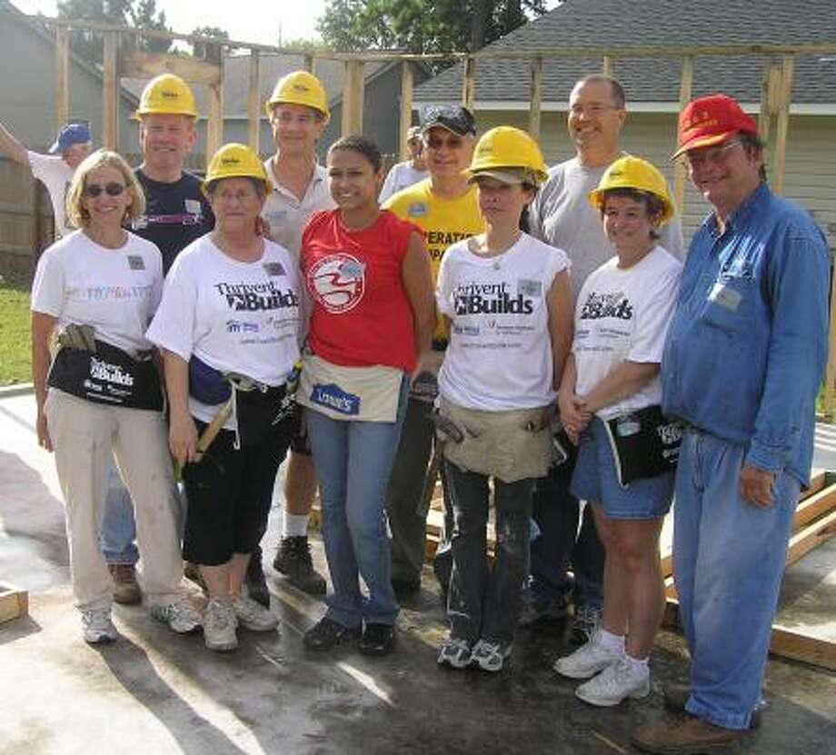 Katy church members joined Houston Habitat for Humanity to build a house for a single mother. The building crew included Sara Trapani, left, Mike Roberts, Marianne Powell, Craig Stichentoth, homeowner Christina Gonzales, Gene Fogt, retired Evangelical Lutheran Church of America pastor; Mercedes Baughman, Pastor Mike Aus, Bev Stichentoth and Ben Powell.
