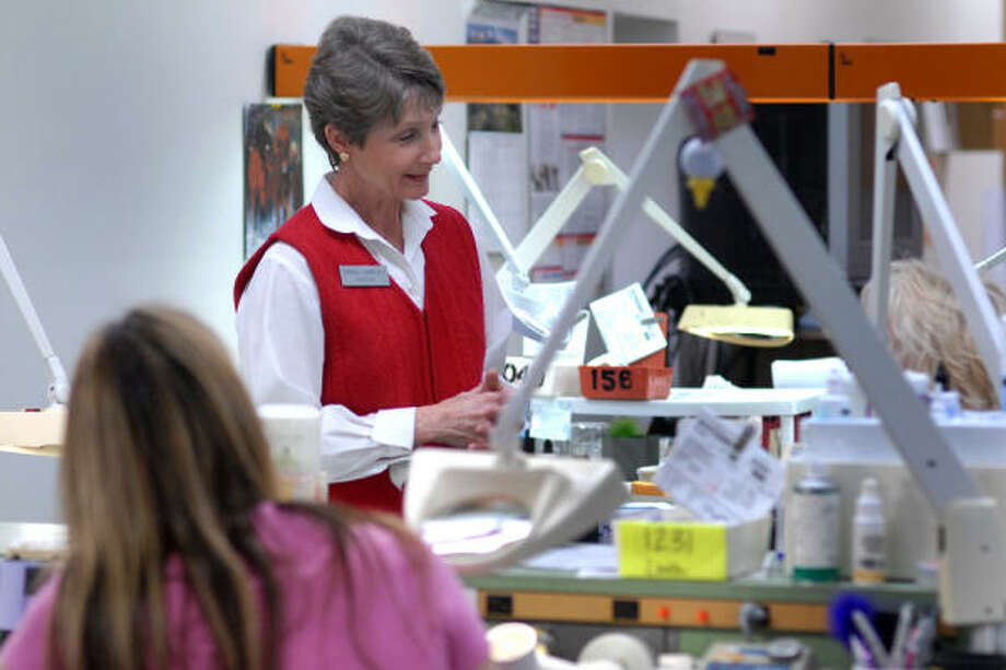 Nancy Graves, chaplain and area team manager for the Gulf Coast Division of Marketplace Chaplains USA, visits with employees at Choate Ceramic Laboratory in Conroe. The chaplains visit the lab once a week to talk to the employees. Photo: David Hopper, For The Chronicle