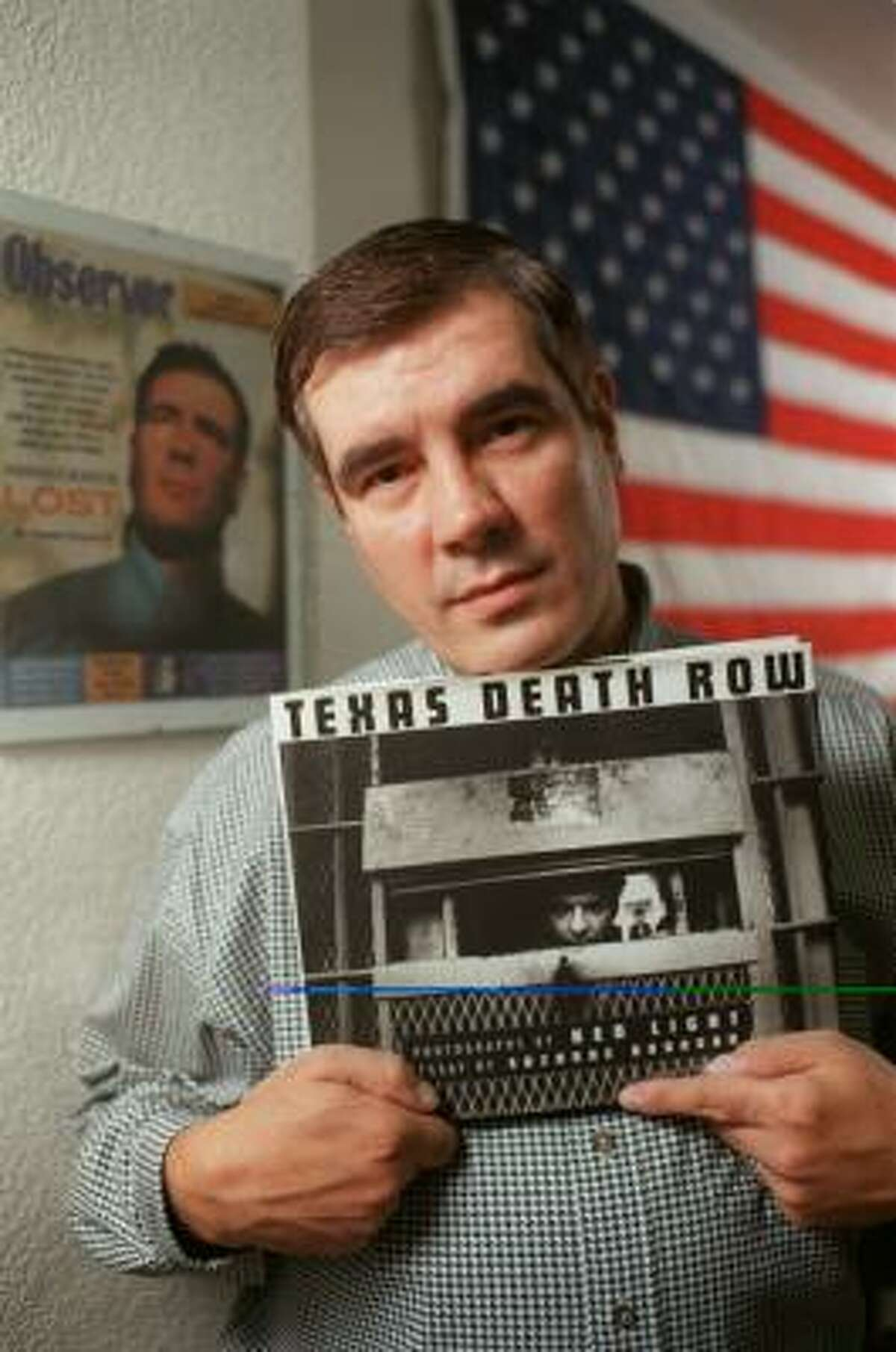 In a 1999 photo, Kerry Max Cook holds Texas Death Row, a book by Suzanne Donovan. Cook served 20 years there.