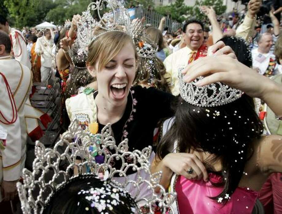 Dana Kurth, left, reacts as she and other members of the the Fiesta court break cascarones, or confetti eggs, over each other during the opening ceremony for Fiesta in San Antonio, Friday. Photo: Eric Gay, AP