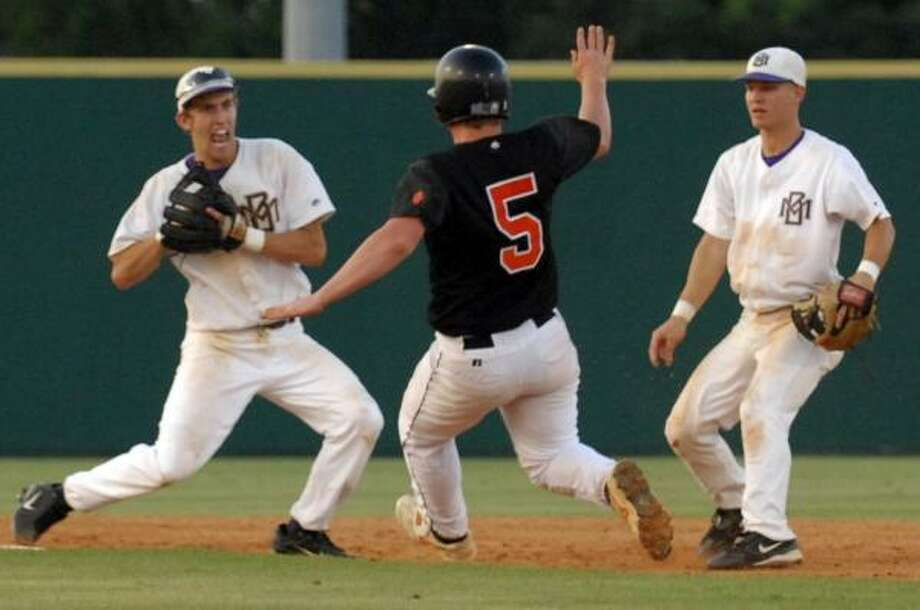 Texas City's Trey Strickland tries to break up a double play attempt by Montgomery's Seth Hill Photo: BRUCE W. MOORE, FOR THE CHRONICLE