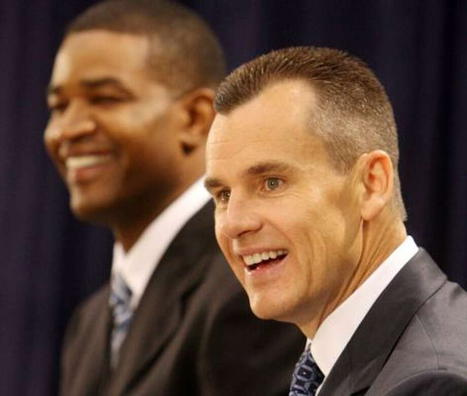 Billy Donovan, right, seemed at ease with his decision when he was introduced as the new Magic coach by general manager Otis Smith, left, on Friday. Photo: RED HUBER, MCCLATCHY-TRIBUNE