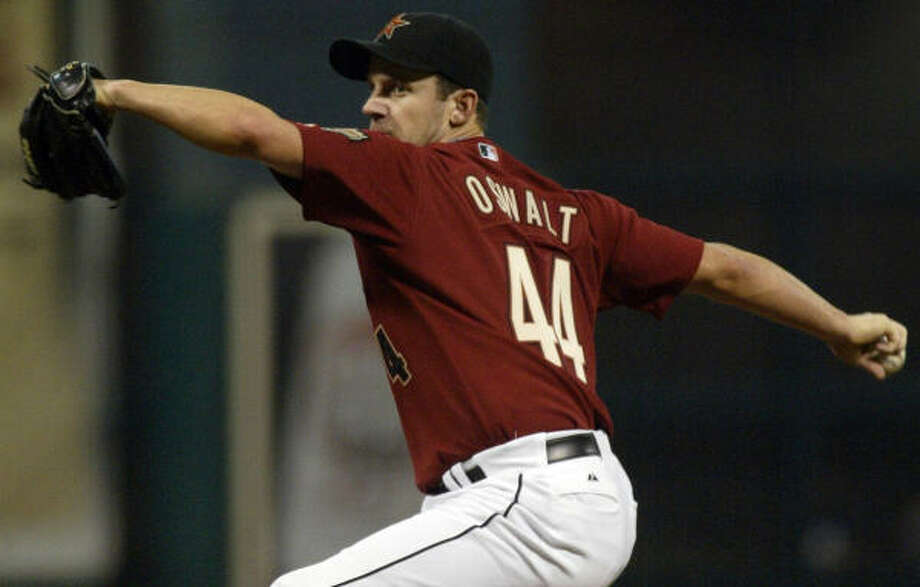 Roy Oswalt scattered 12 hits over 5 2/3 innings to pick up his first win since May 12. Photo: Jessica Kourkounis, AP