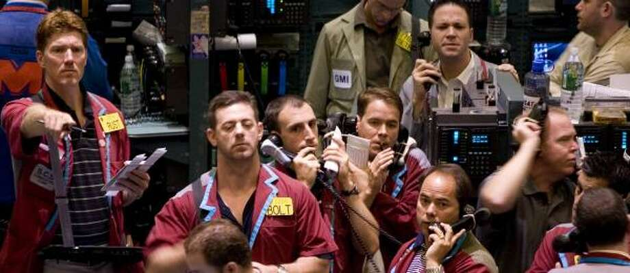 Traders deal in crude oil futures Thursday at the New York Mercantile Exchange. Oil prices rose, but are still 3 percent below last Friday's close. Photo: MARK LENNIHAN, ASSOCIATED PRESS