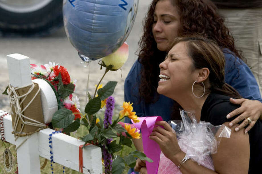 Lorena Gutierrez, right, mother of 16-year-old Jennifer Medina, is embraced by her sister, Maria Angeles, as they visit the site of a fatal accident Friday, Aug. 24, in Houston, that claimed the lives of Medina and two others. Photo: Brett Coomer, Chronicle