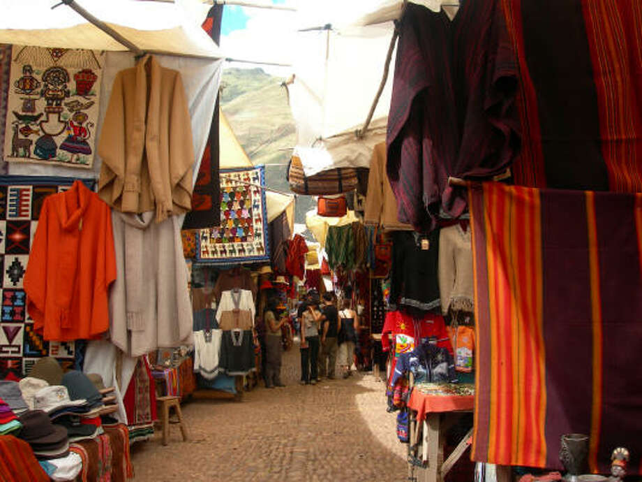The Pisac Market is a great place to shop for souvenirs in Peru's Sacred Valley of the Inca. Photo: Eileen McClelland, For The Chronicle