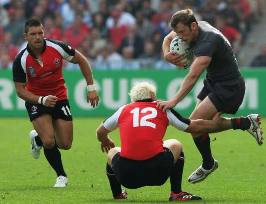 Dave Spicer of Canada tackles Kevin Morgan of Wales, but Wales won their Rugby World Cup 2007 Pool B match 42-17. Photo: STU FORSTER, GETTY IMAGES
