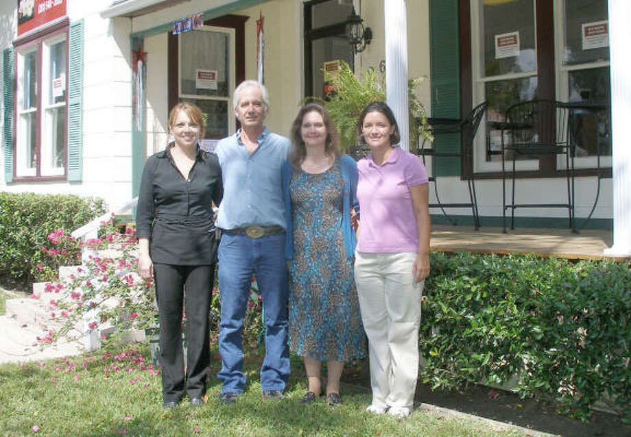 Manager Ninfa Guajardo, owners John and Robin Hanna, and Assistant Manager Christine Chisp stand in front of the new Magnolia Gardens Tea Room & Gift Gallery at 601 First Street in Humble. Photo: Harry Williamson