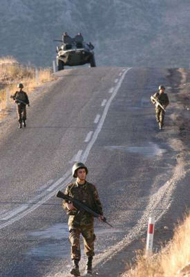 Turkish soldiers patrol a highway near the Turkish-Iraqi border Thursday. Photo: KADIR KONUKSEVER, ASSOCIATED PRESS