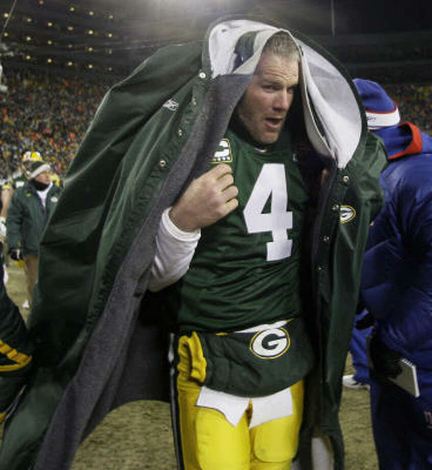 Brett Favre ended the season like he did most of them: fighting to the very end. Photo: David J. Phillip, AP