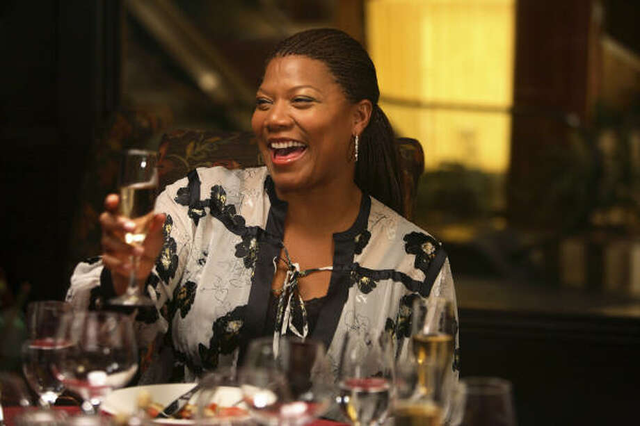 Queen Latifah stars as Nina, a Federal Reserve employee, in Mad Money. Photo: Overture Films