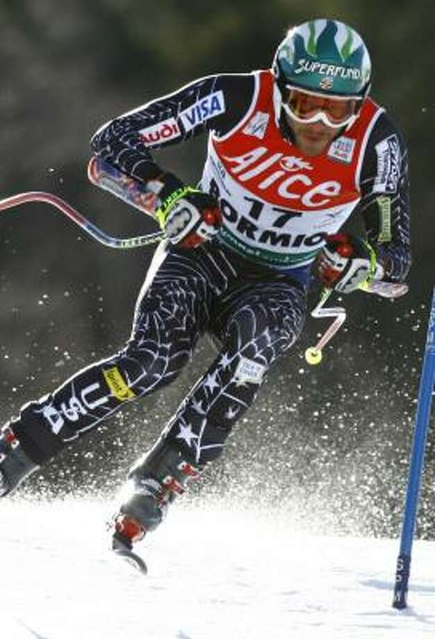 Bode Miller speeds down the course during a men's Super-G race en route to his second overall World Cup title. Photo: ALESSANDRO TROVATI, AP