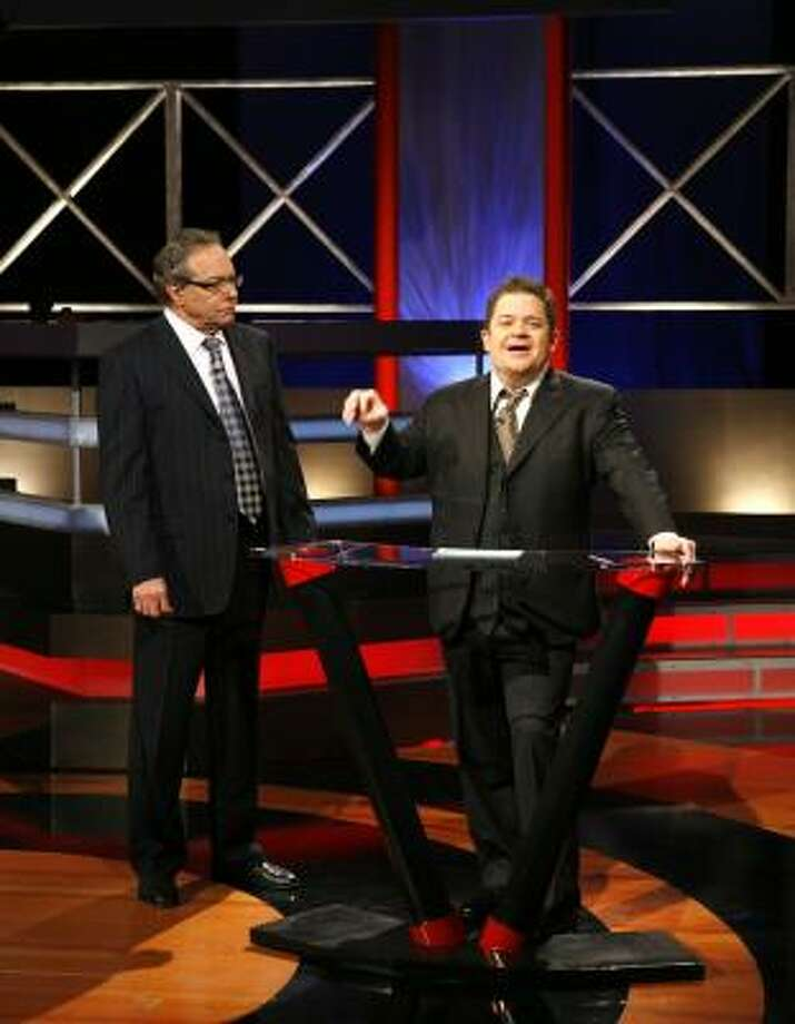 Patton Oswalt, right, appears with Lewis Black, left, on the new show Lewis Black's Root of All Evil. Photo: EVANS WARD, COMEDY CENTRAL