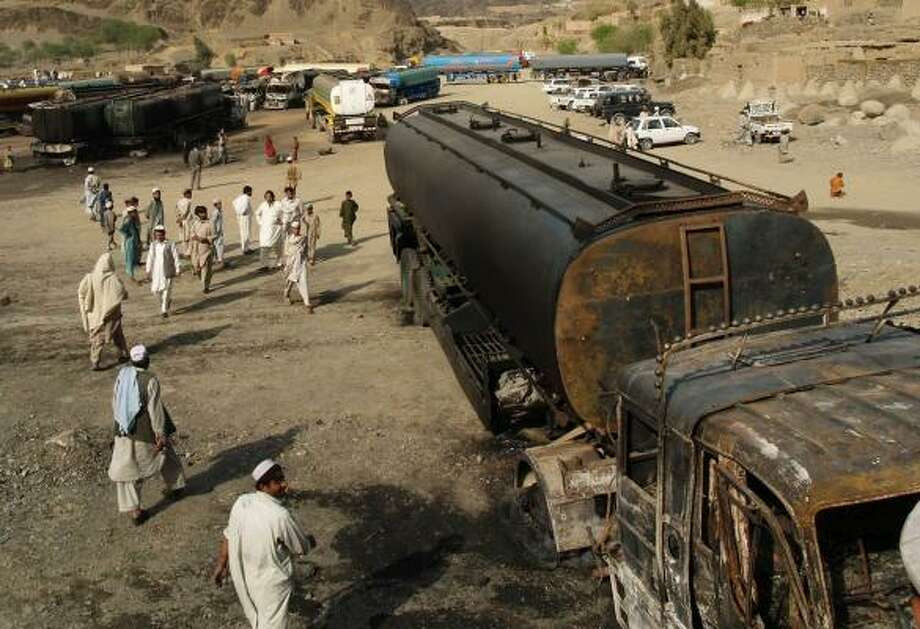 Nearly 40 trucks carrying fuel to coalition forces were destroyed during a March bombing on the Pakistan-Afghanistan highway. Photo: MOHAMMAD ZUBAIR, ASSOCIATED PRESS FILE