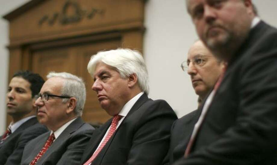 Martin Sullivan, center, former CEO of AIG, waits to testify before the House Oversight and Government Reform Committee on Tuesday. Lawmakers scolded executives for going on a $440,000 corporate retreat after receiving a loan from the government to stave off bankruptcy. Photo: LAWRENCE JACKSON, ASSOCIATED PRESS