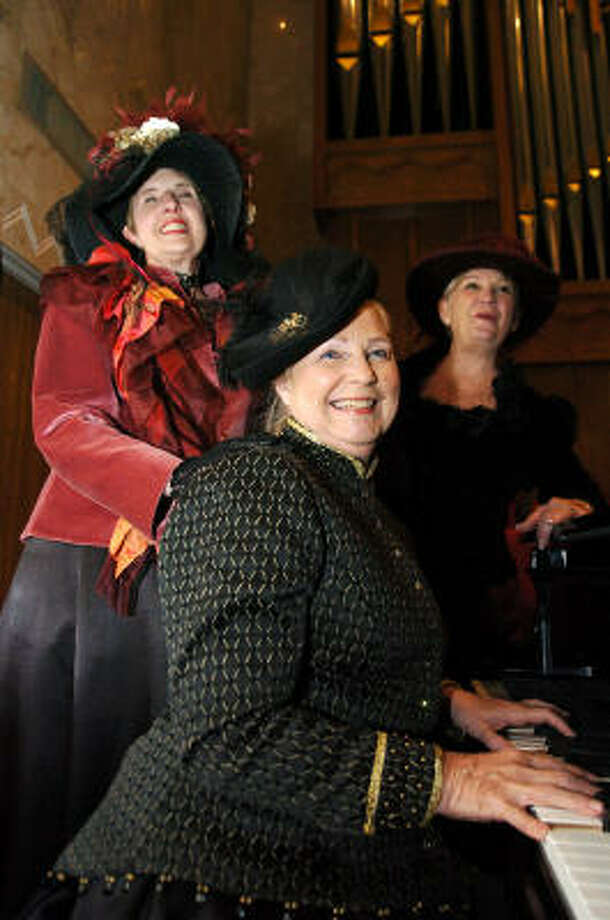 Galveston Historical Foundation volunteers Janet Morris, left, Leslie Watts and Mary Branum practice their carols as they prepare for Dickens on The Strand. Photo: Kirk Sides