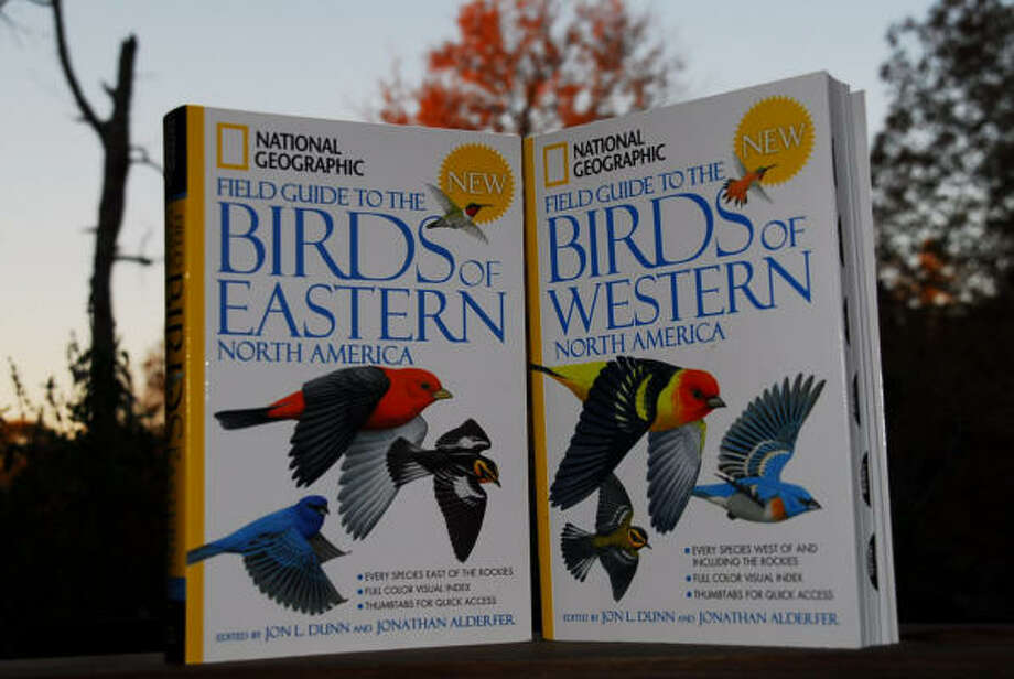 HAVE IT COVERED: These National Geographic books help identify the different species of birds in North America. Photo: CHRONICLE FILE