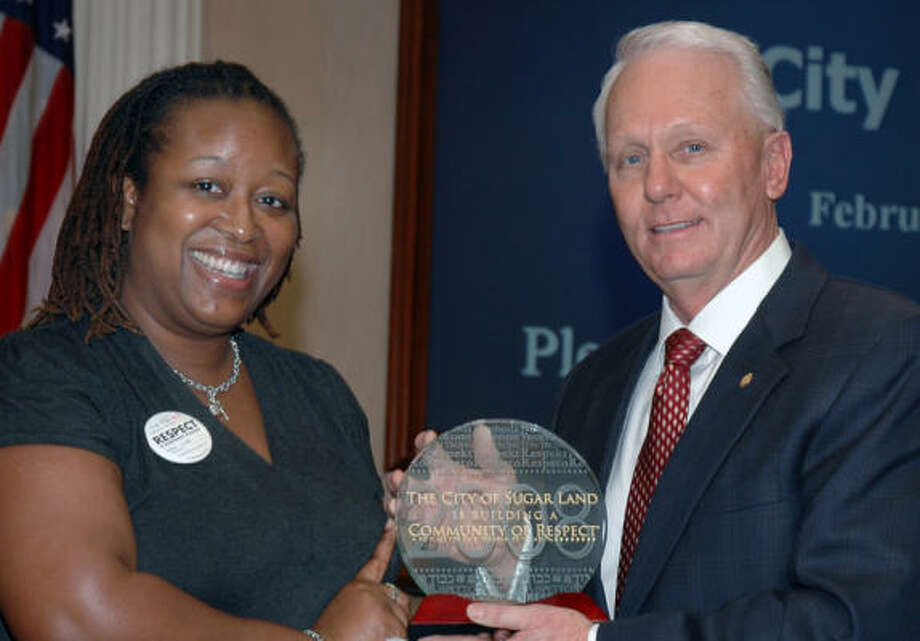LaMonica Yarbrough, Community of Respect project coordinator of the Anti-Defamation League, presents Sugar Land Mayor James A. Thompson, with the city's second consecutive Community of Respect award. Photo: Courtesy, City Of Sugar Land