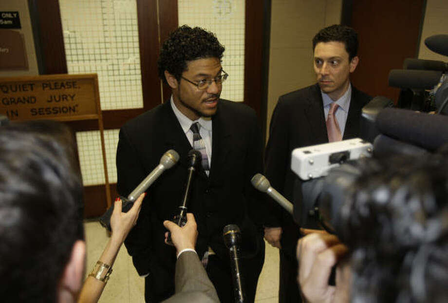 Robert Tolan, center, shown with his attorney Geoffrey Berg, right, speaks to the media after his appearance before a Harris County grand jury on Monday. Photo: Melissa Phillip, Chronicle