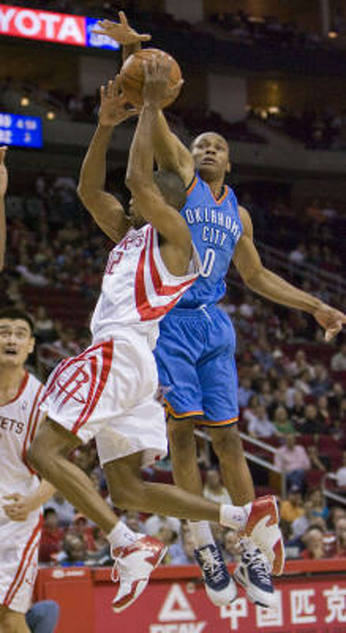 Rafer Alston is fouled as he goes to the basket by Oklahoma City's Russell Westbrook in the first half.