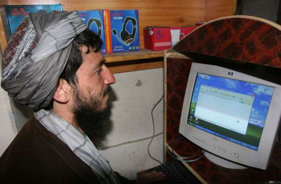A man works in an Internet cafe in the Kandahar province in Afghanistan. The quality of al-Qaida's multimedia productions has improved over the past few years. Photo: Allauddin Khan, Associated Press
