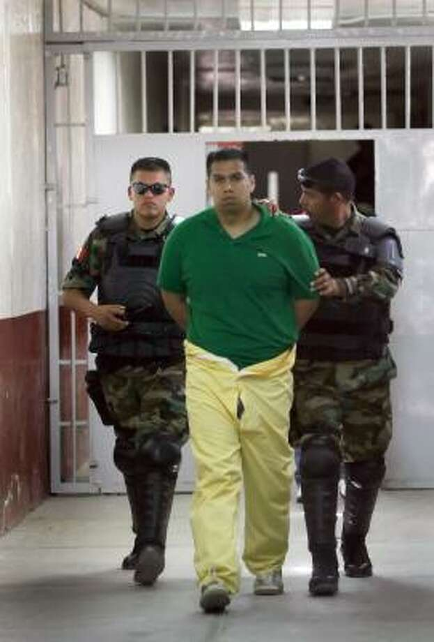 Spc. Richard Torres remains in a Ciudad Juarez jail. He says he accidentally drove into Mexico with his firearms. Photo: ADRIANE JAECKLE, AP