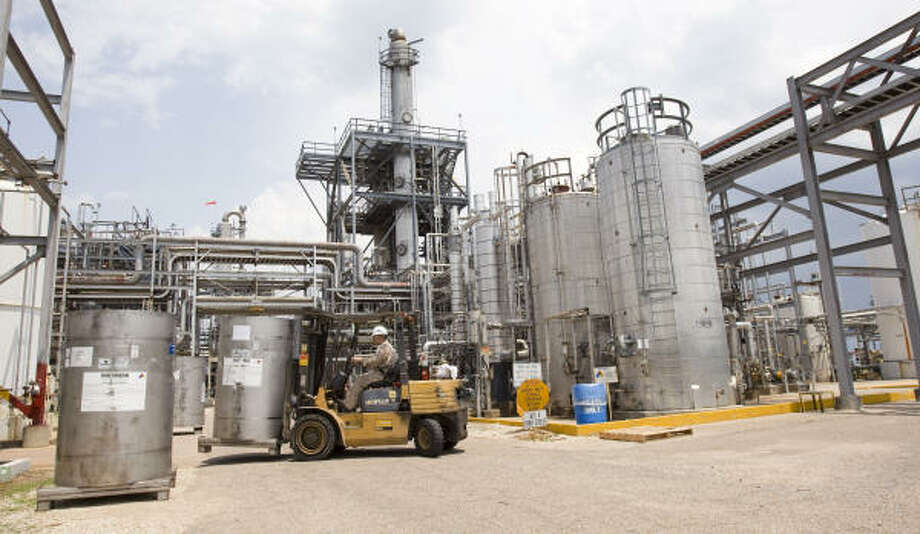 Chemicals are moved at the Huntsman Corp. plant in Conroe on Wednesday. Huntsman's board approved another extension for closing the deal for a takeover by Hexion Specialty Chemicals, refusing to abandon the $11 billion deal. Photo: Brett Coomer, Chronicle