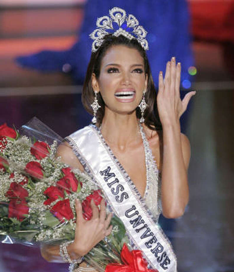 Zuleyka Rivera Mendoza, Miss Puerto Rico 2006, reacts after winning the Miss Universe 2006 pageant on Sunday. Photo: MARK J. TERRILL, AP