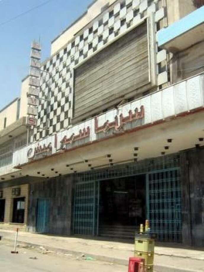 Few Baghdad residents venture to the Semiramis cinema. The 1,800-seat theater used to feature seven films daily. Now it closes at 2:30 p.m. Photo: Joshua PARTLOW, Washington Post