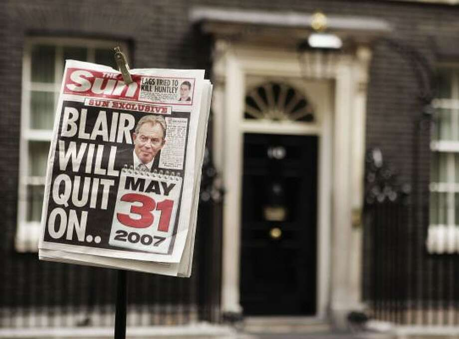 In this photo illustration, a TV crew placed a newspaper on a light stand outside Prime Minister Tony Blair's office. Photo: Peter Macdiarmid, Getty Images