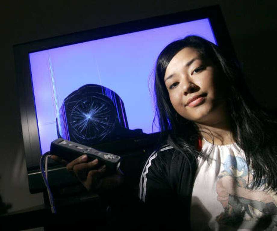 Jaana Baker, 23, cracked her 37-inch flat-screen TV during a spirited round of Wii bowling after the wrist strap on the system's controller, or Wiimote, snapped off. Photo: Chris Carlson, AP