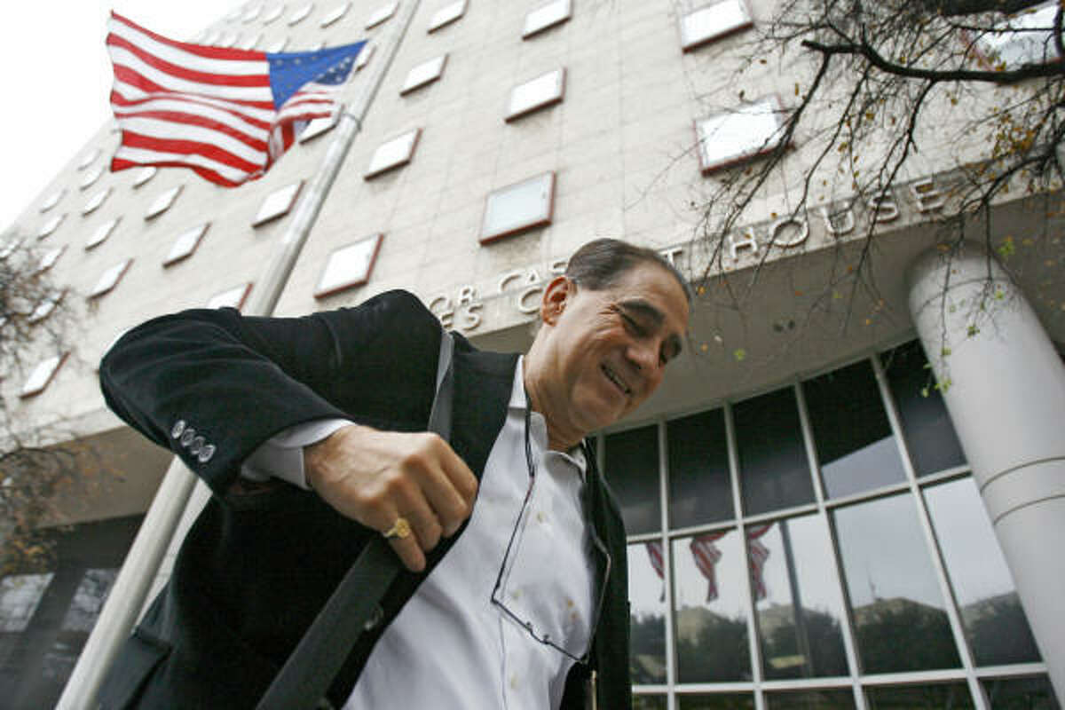 Ben Reyes, the city's first Hispanic councilman, leaves Bob Casey Federal Courthouse on Friday.