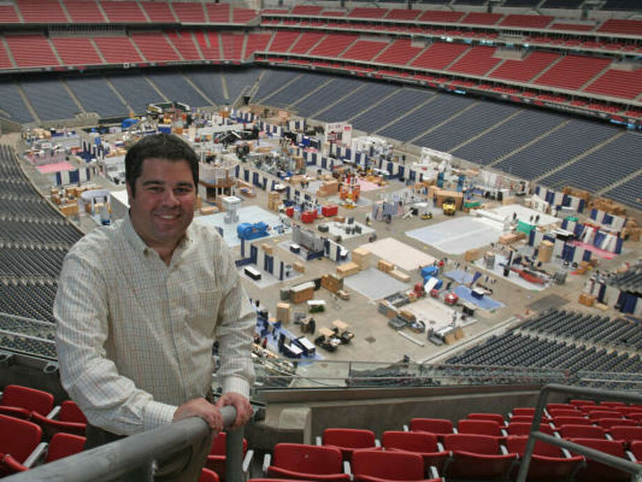 Juan Rodriguez, who helps supervise setting up events at Reliant Park, keeps track as workers begin assembling exhibits for the upcoming Offshore Technology Conference. Photo: Gary Fountain, For The Chronicle