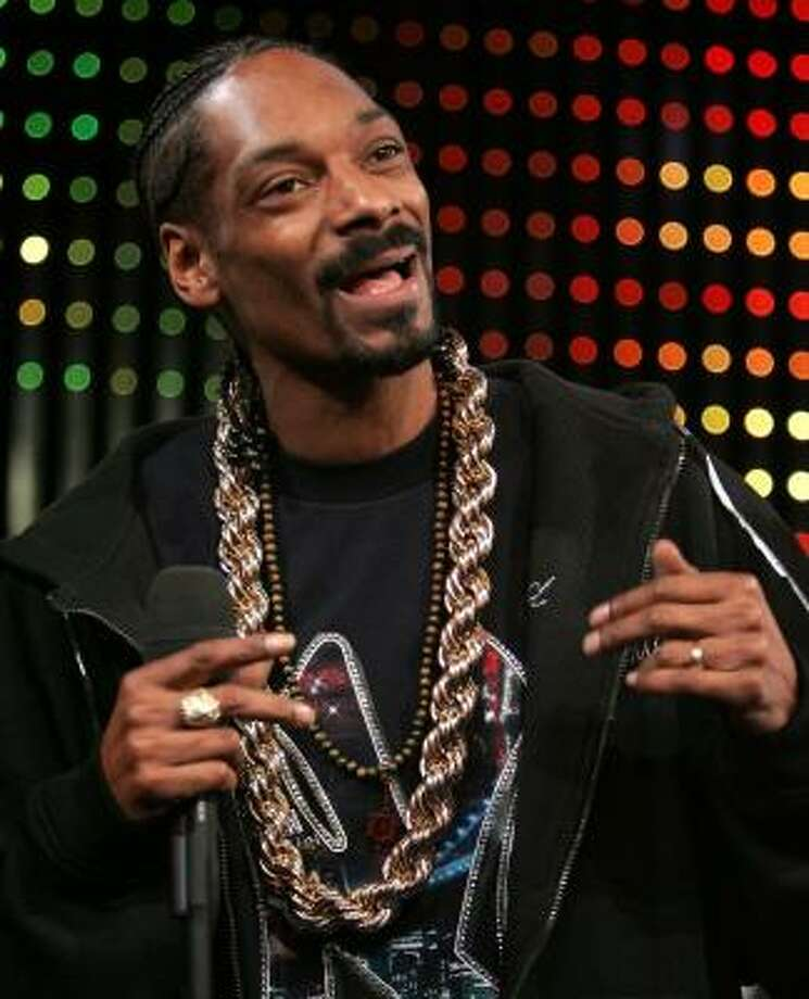 Rapper Snoop Dogg, above, may have a few problems with the law, but his mother, Beverly Broadus Green, believes all that will change. Photo: BRYAN BEDDER, GETTY IMAGES