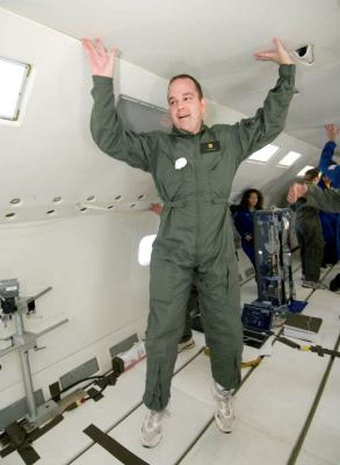 "SciGuy Eric Berger flies aboard NASA's ""Weightless Wonder,"" a military version of the DC-9 aircraft that flies parabolas in the atmosphere to produce zero-gravity conditions. NASA uses the flights to conduct experiments in micro-gravity. Photo: NASA"