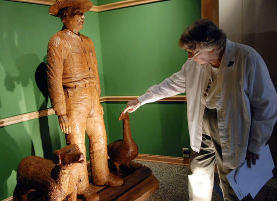 Cleo Congrady talks about one of the sculptures in the entryway of the Alvin Historical Museum. Photo: Kim Christensen, For The Chronicle