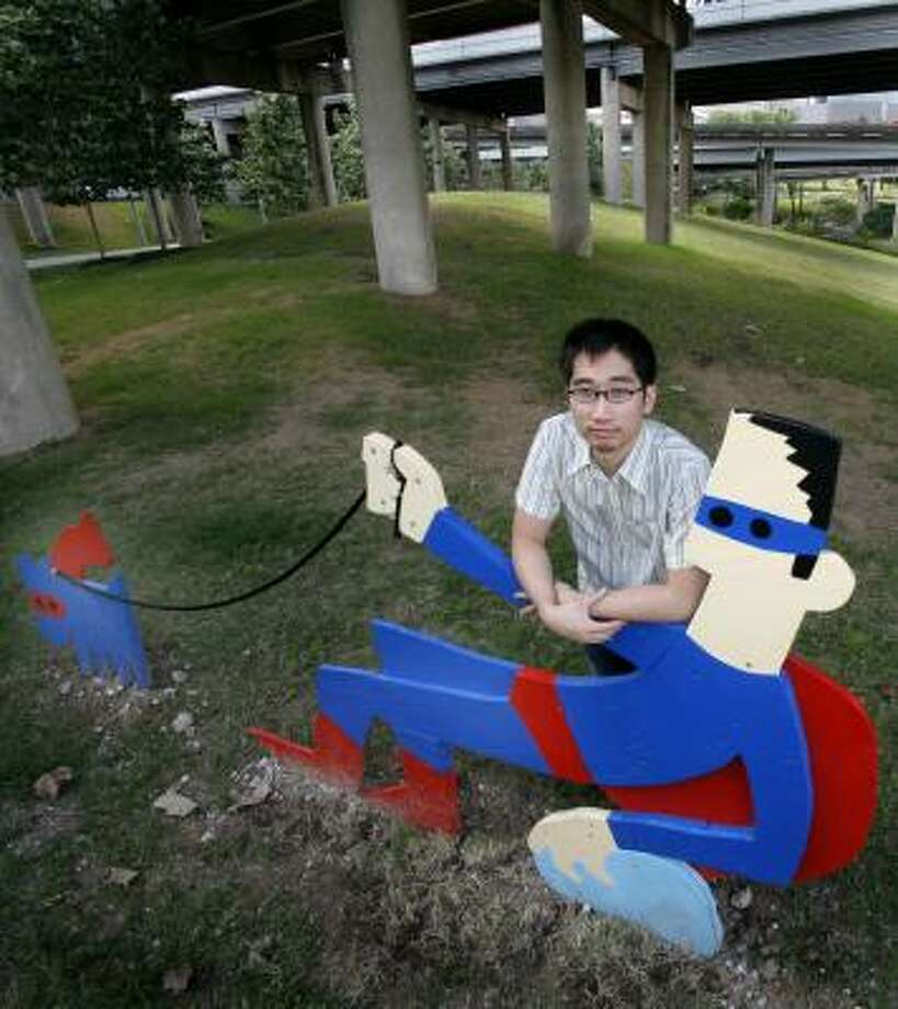 David Chien, a local artist and creator of the larger-than-life Superhero Alter Egos at the Buffalo Bayou ArtPark, is a graphic artist by day. Photo: STEVE UECKERT, CHRONICLE