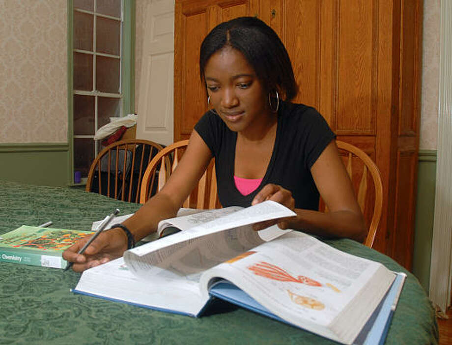 Nyembezi Moyo, of Zambia, studies at the home of Dan and Teri Sumners-Minette in The Woodlands, where she is staying. Moyo attends Texas Christian University in Fort Worth, and wants to become a doctor and return to her country to practice. Photo: David Hopper, For The Chronicle