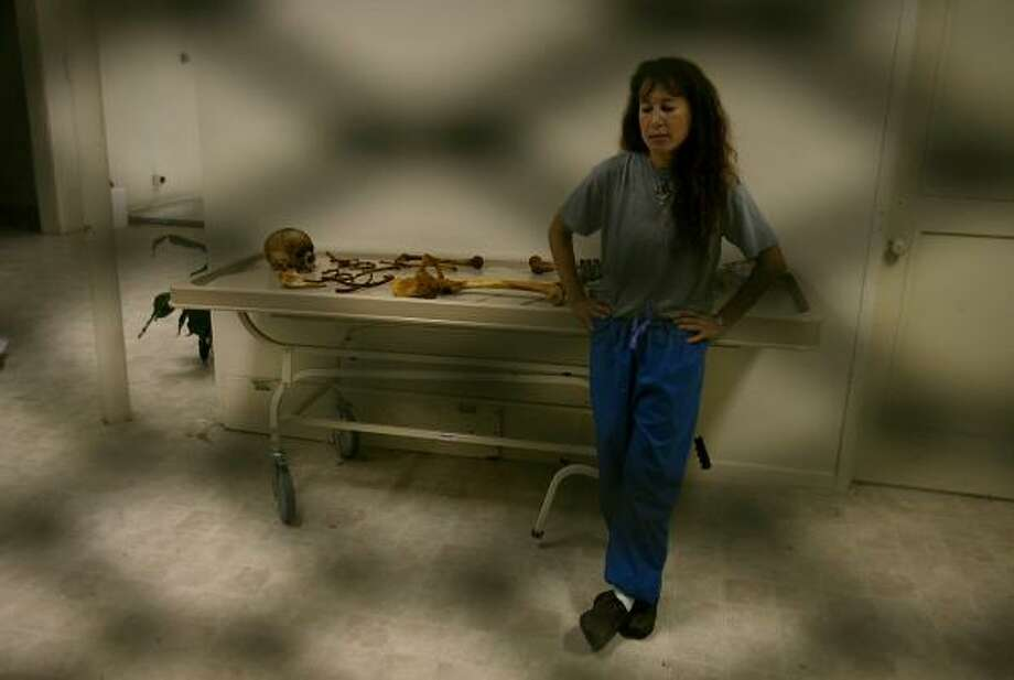 Dr. Corinne Stern, the Webb County medical examiner, is re-examining skeletal remains found in the area years ago. Some bones are stored in boxes in the hallway of an old prison outside Laredo because there is not enough room in a walk-in cooler. Photo: MAYRA BELTRÁN PHOTOS, CHRONICLE