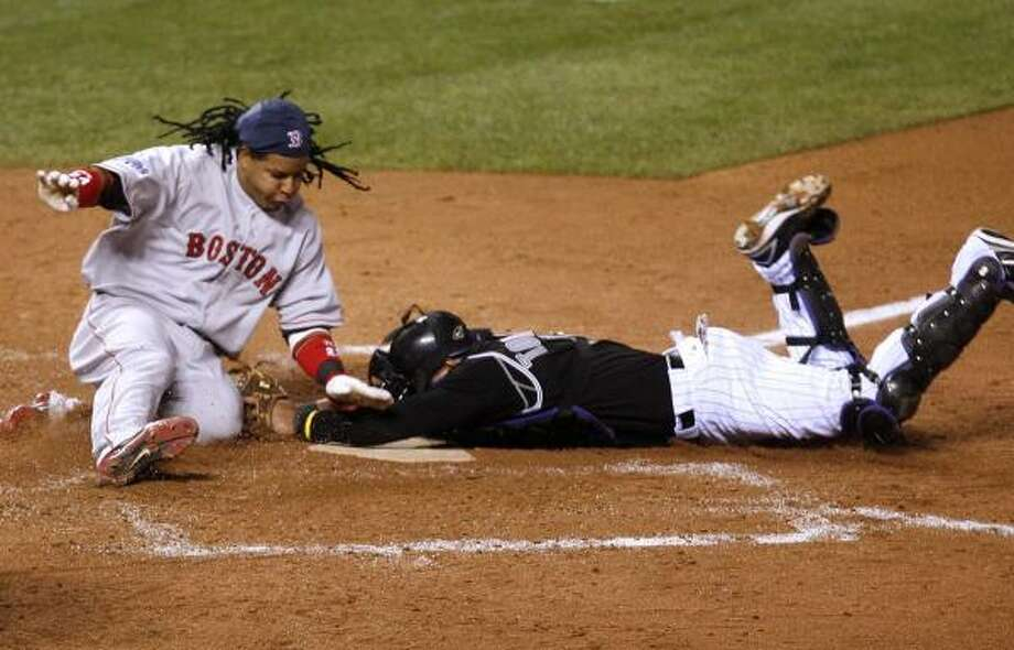 Manny Ramirez is out at home during Game 3. Photo: ROBERT CAPLIN, BLOOMBERG NEWS