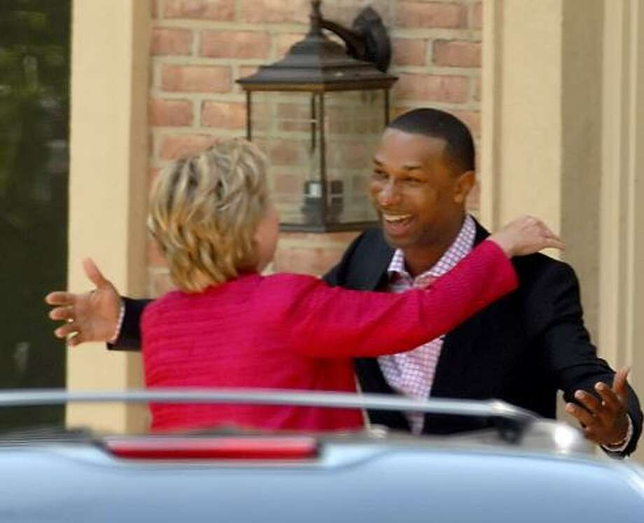 North Carolina businessman and 'bundler' Johnny Taylor Jr. greets Sen. Hillary Clinton during a May fundraiser. Photo: DIEDRA LAIRD, CHARLOTTE OBSERVER