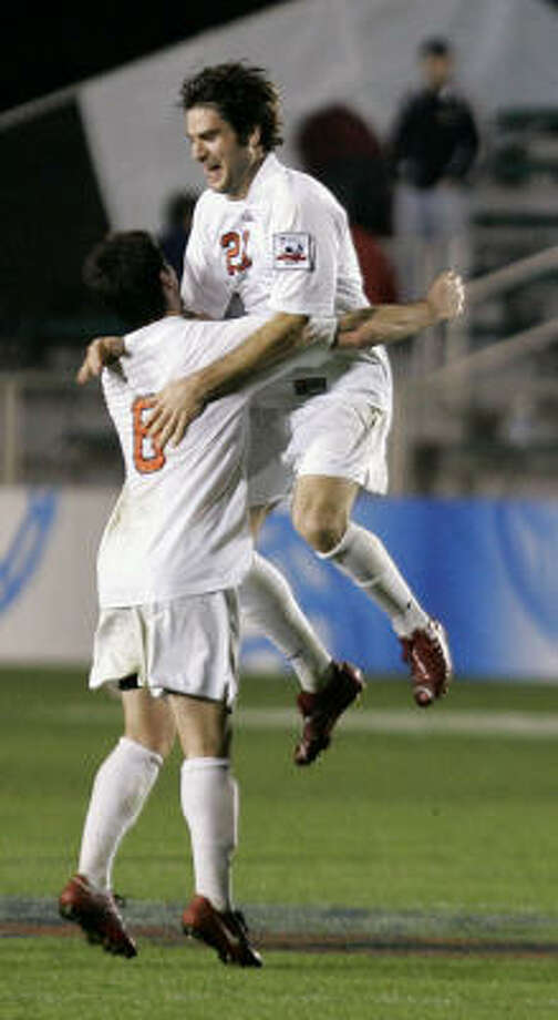 Ohio State's Danny Irizarry (8) and Steven Traeger celebrate following an NCAA College Cup national semi-final soccer game. Ohio State won 1-0, and will play Wake Forest for the national championship. Photo: Gerry Broome, AP