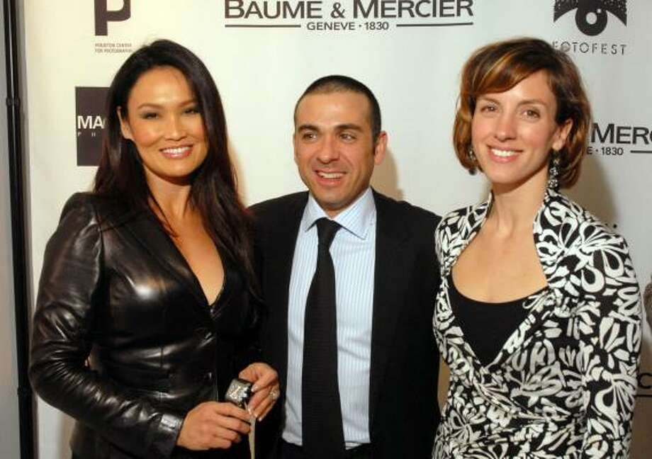 Actress Tia Carrere, from left, Baume & Mercier CEO Michel Nieto and Houston Center for Photography director Madeline Yale were key figures at the Baume & Mercier reception featuring the Moments in Time photography exhibition. Photo: DAVE ROSSMAN, FOR THE CHRONICLE
