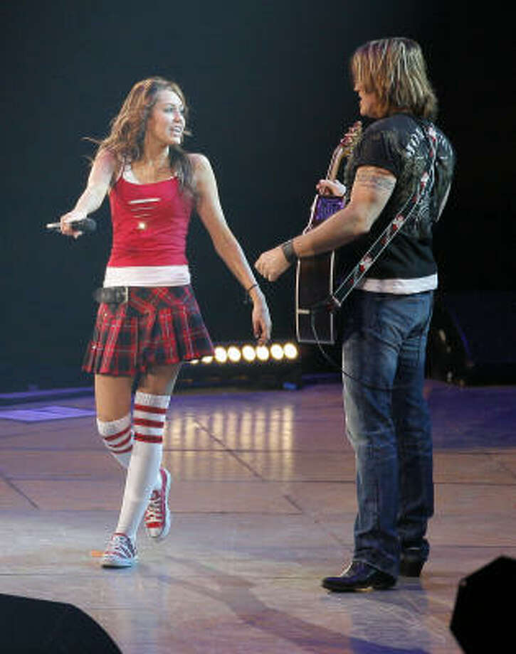 Miley and Billy Ray Cyrus perform on stage at the Houston Livestock Show and Rodeo in 2008. Photo: Steve Campbell, Chronicle