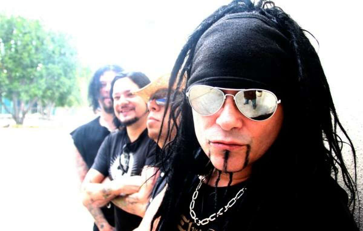 """Al Jourgensen (foreground) says Ministry is calling it quits. """"We're not doing the Botox circuit. Never,"""" he says. Ministry also includes, from left, Paul Raven, Thomas M. Victor and Sin Quirin."""