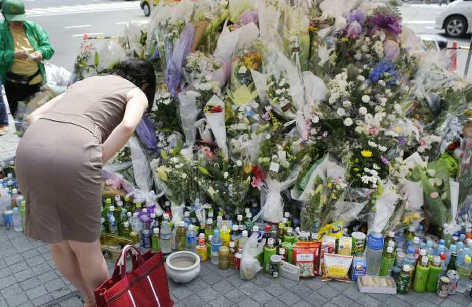 "Prayers are offered for victims of the June 8 rampage in which seven people were stabbed to death in Tokyo's Akihabara shopping district. Some say the attack was forewarned in a Web site called ""Extreme Exchange, Revised"" and apparently ignored. Photo: ITSUO INOUYE, ASSOCIATED PRESS"