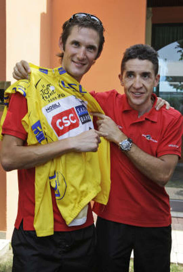 Carlos Sastre of Spain, right, and new overall leader Frank Schleck of Luxemburg, pose with the yellow jersey on the rest day of the Tour de France. Photo: BAS CZERWINSKI, AP